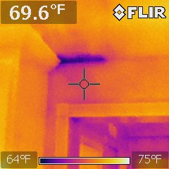 This picture was taken during an efficiency inspection requested from the seller.  The bright blue area in the corner, is energy (air) loss from the master bedroom